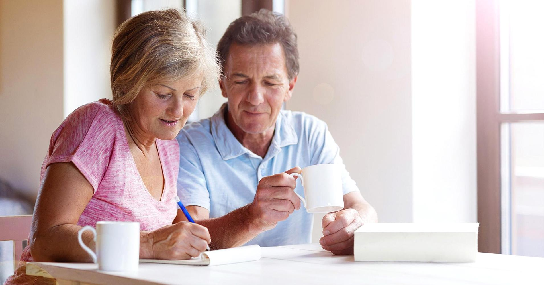elderly couple reviewing their finances