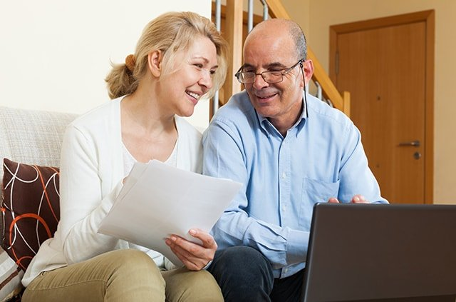 Couple reviewing insurance financing